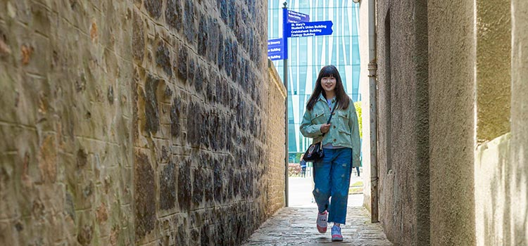 A student walking through the streets of Aberdeen
