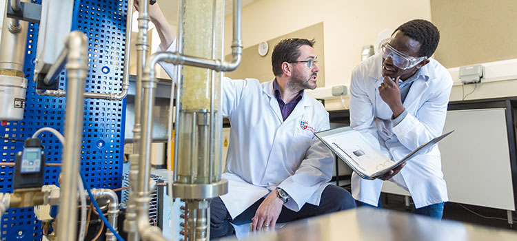 An international student works with a professor in an engineering lab at the University of Aberdeen