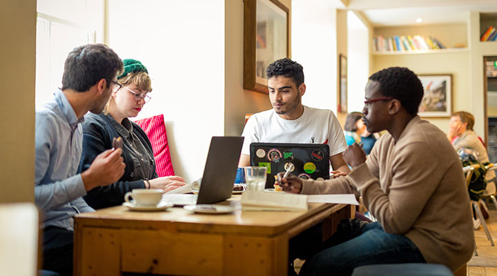 A group of international students studying in a coffee shop in Aberdeen