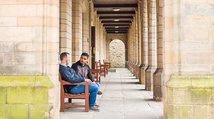 Two students on campus at the University of Aberdeen